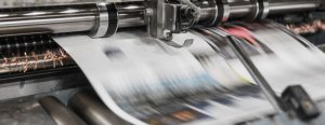 Newspapers printed on a traditional press